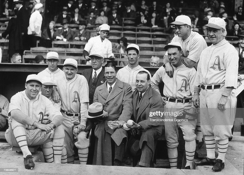 PHILADELPHIA - OCTOBER 1, 1930. A group of American League Champion and soon to be World Champion Philadelphia Athletics pose for a dugout photo before game one of the World Series in the Baker Bowl in Philadelphia in October of 1930. Lefty Grove is standing tall at the back, and Jimmy Foxx is leaning on Mule Haas' shoulders.