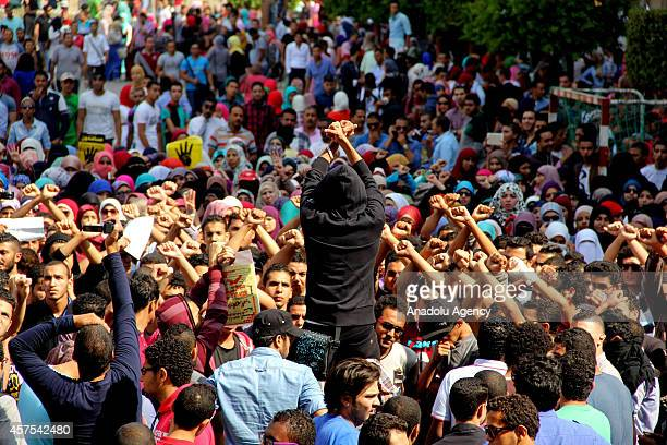A group of anticoup Egyptian students gather to protest outside the Cairo University in Cairo Egypt on October 20 2014