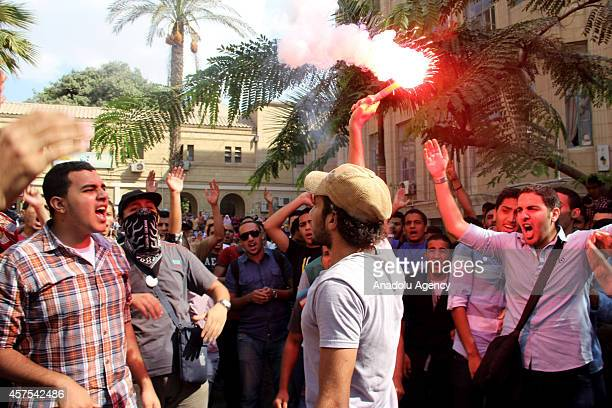 A group of anticoup Egyptian students gathered outside the Cairo University chant slogans during a protest in Cairo Egypt on October 20 2014