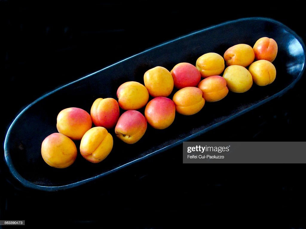 Group of Apricot in a black bowl