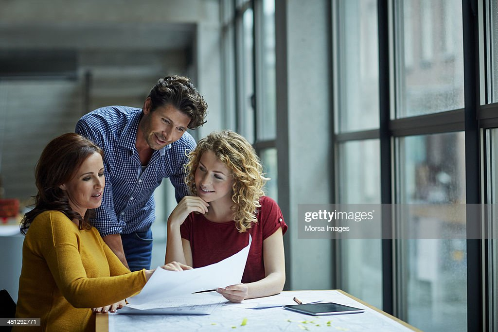 Group of architects discussing projects : Stock Photo