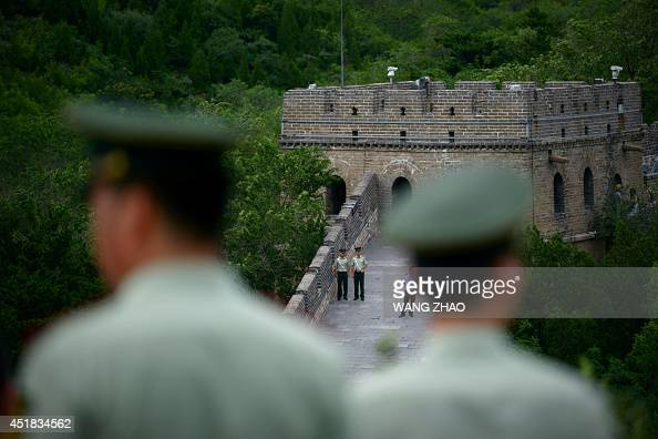 A group of armed police look on at The Great Wall of China during a visit by US Secretary of State John Kerry and US Secreary of the Treasury Jacob...