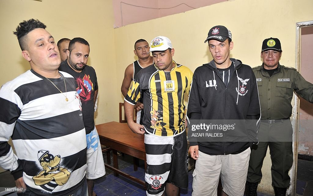 A group of arrested Corinthian fans are depicted at San Pedro jail in Oruro, 240 km from La Paz, on March 15, 2013. The Brazilian supporters are being kept under custody on charges of having taken part in the murder of San Jose de Beltran's supporter Kevin Beltran during the San Jose de Beltran vs Corinthians Libertadores Cup match on February 20, 2013. AFP PHOTO/Aizar Raldes