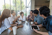 Group of Asian Business People with casual suit are meeting in the modern Office or coffee shop, people group shot concept