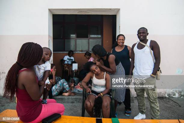 A group of asylum seekers from Nigeria pose for a picture inside the Hub CARA center on July 27 2017 in Bologna Italy In an effort to address the...