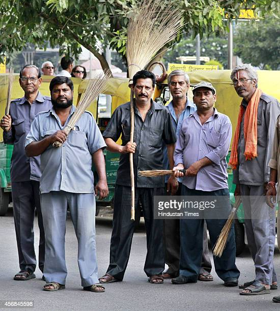 A group of Auto Drivers participating in Swachh Bharat Abhiyan at Barakhamba Road on October 8 2014 in New Delhi India Swachh Bharat Abhiyan or...