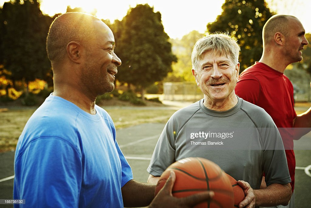 Group of basketball players on outdoor court