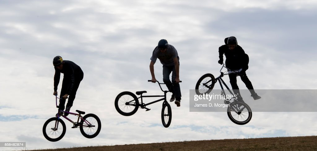 A group of BMX bicycle freestyle athletes jump on October 7, 2017 in Sydney, Australia. The Big Adventure at Sydney Park is part of the month-long Sydney Rides Festival, aimed at encouraging Sydney residents to get outdoors and active.