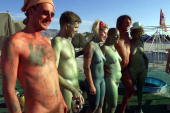 A group of bodypainters pose during a performance at Black Rock City's Burning Man festival in Nevada 02 September 1999 Founded in 1986 by a group of...