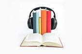 Group of books and headphones related to audiobooks, E-books and digitally listening conversations and storytelling of written books on isolated background