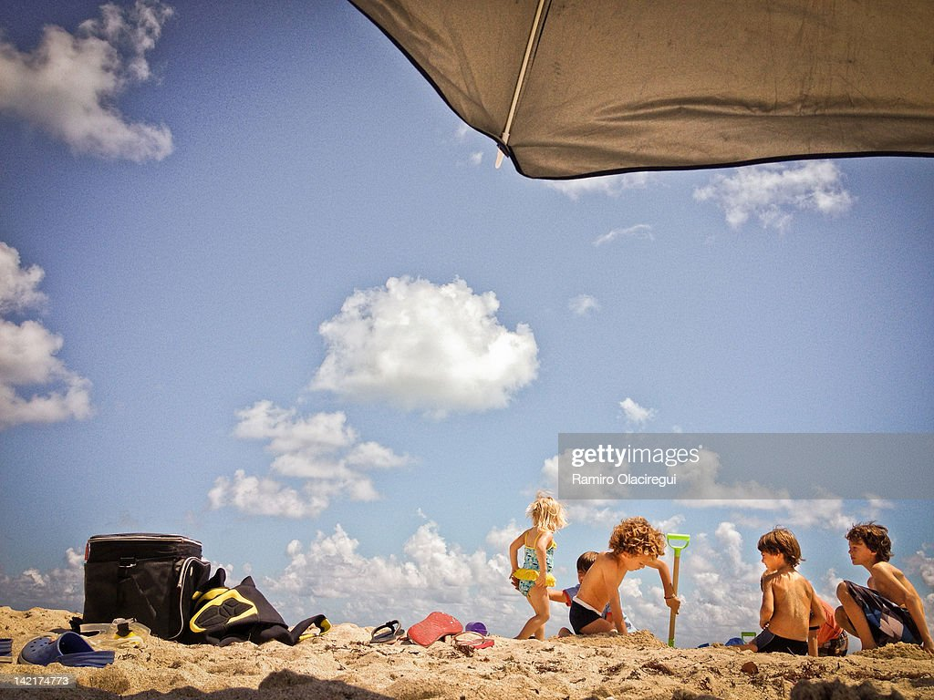 Group of boys and girl playing on beach : Stock Photo