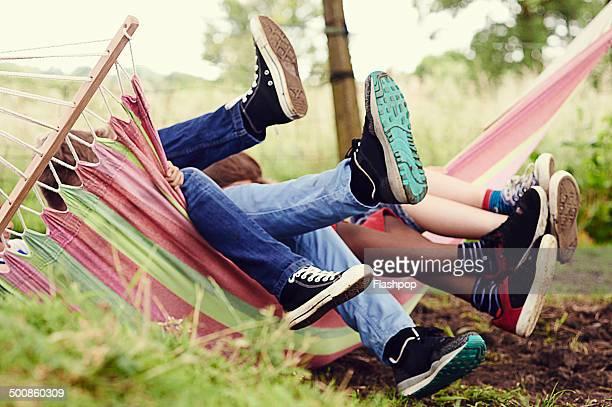 Group of boys having fun on a hammock