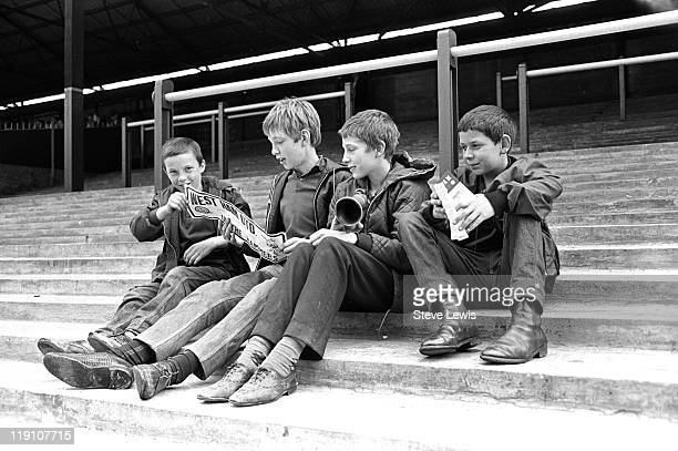 A group of boys on an empty terrace at the West Ham United stadium at Upton Park east London circa 1970