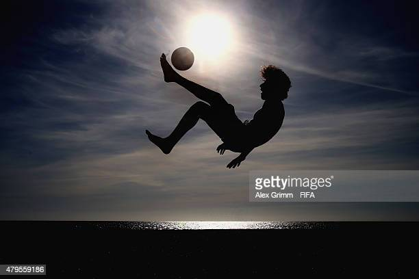 A group of boys play football on the beach ahead of the FIFA Beach Soccer World Cup Portugal 2015 on July 5 2015 in Espinho Portugal