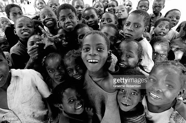 A group of boys smile for the camera on June 30 2005 in Mozambique Since Mozambique's 15year civil war ended in 1992 the country has made a strong...