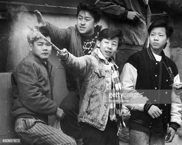 A group of boys usher in the Chinese New Year with fireworks in Boston's Chinatown on Feb 12 1989 It is the Year of the Snake according to the...