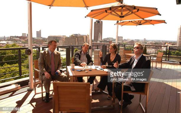 A group of British American Tobacco employees take a cigarette break in the company's new rooftop smokers area at Globe House in the City of London...
