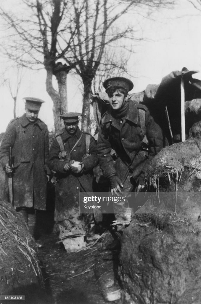 A group of British infantrymen in their makeshift quarters in a trench in France during World War I circa 1915 One of them is peeling a swede The...