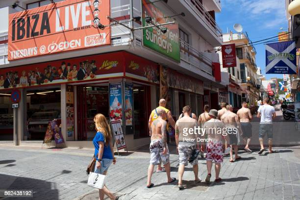 A group of British men most of who are not wearing shirts head in to the part of San Antonio town Ibiza known as the West End The fine for not...