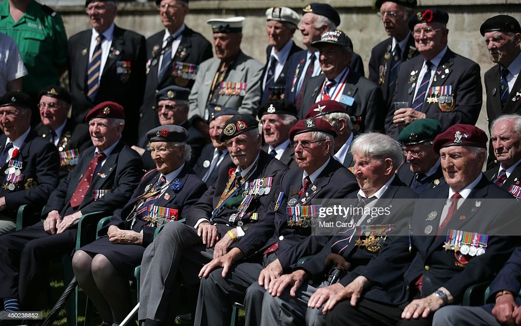 A group of British Normandy Veterans pose for a group photograph as they visit Sainte-Mere-Eglise which is holding D-Day Commemorations on June 7, 2014 in Normandy, France. Yesterday was the 70th anniversary of the D-Day landings, which saw 156,000 troops from the allied countries including the United Kingdom and the United States join forces to launch an audacious attack on the beaches of Normandy, these assaults are credited with the eventual defeat of Nazi Germany.