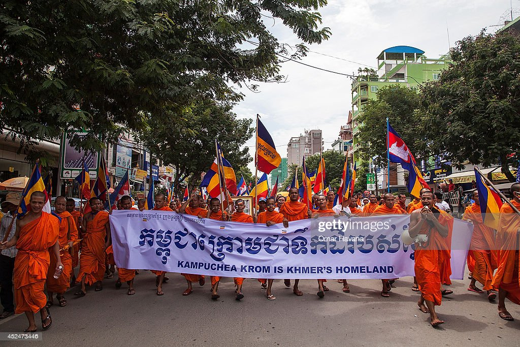 A group of Buddhist monks lead a demonstration through the city streets holding a banner demanding the return of the Kampuchea Krom territories to Cambodia on July 21, 2014 in Phnom Penh, Cambodia. Thousands of protesters and monks march through the streets of Phnom Penh to deliver petitions to the French, British, American, Russian and Chinese embassies, before arriving at the Vietnamese Embassy. The protesters, organised by the Federation of Cambodian Intellectuals and Students (FCIS) and leaders of the Khmer Krom community, are demanding an apology from Vietnamese Embassy First Counsellor Tran Van Thong, who recently said that the former Kampuchea Krom provinces were held by Vietnam before their occupation by France. Ahead of the protest, Phnom Penh municipal authorities banned the protest, threatening the protesters who defied the ban could be jailed for up to 15 years.
