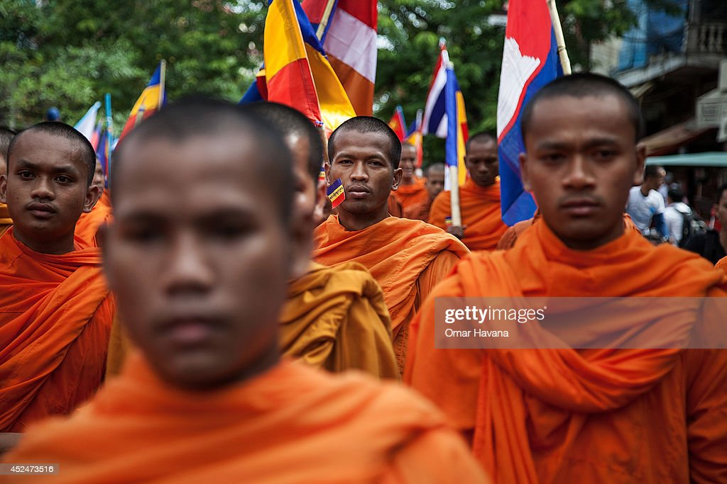 A group of Buddhist monks lead a demonstration through the city streets on July 21, 2014 in Phnom Penh, Cambodia. Thousands of protesters and monks march through the streets of Phnom Penh to deliver petitions to the French, British, American, Russian and Chinese embassies, before arriving at the Vietnamese Embassy. The protesters, organised by the Federation of Cambodian Intellectuals and Students (FCIS) and leaders of the Khmer Krom community, are demanding an apology from Vietnamese Embassy First Counsellor Tran Van Thong, who recently said that the former Kampuchea Krom provinces were held by Vietnam before their occupation by France. Ahead of the protest, Phnom Penh municipal authorities banned the protest, threatening the protesters who defied the ban could be jailed for up to 15 years.