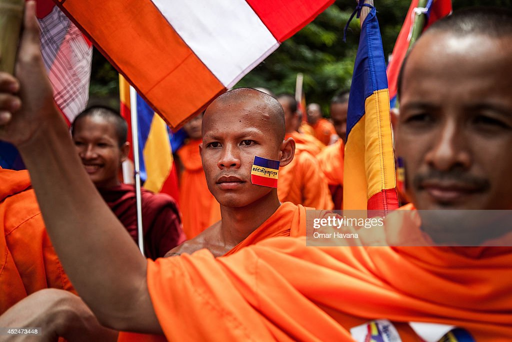 A group of Buddhist monks march during a demonstration through the city streets to deliver petitions to different embassies on July 21, 2014 in Phnom Penh, Cambodia. Thousands of protesters and monks march through the streets of Phnom Penh to deliver petitions to the French, British, American, Russian and Chinese embassies, before arriving at the Vietnamese Embassy. The protesters, organised by the Federation of Cambodian Intellectuals and Students (FCIS) and leaders of the Khmer Krom community, are demanding an apology from Vietnamese Embassy First Counsellor Tran Van Thong, who recently said that the former Kampuchea Krom provinces were held by Vietnam before their occupation by France. Ahead of the protest, Phnom Penh municipal authorities banned the protest, threatening the protesters who defied the ban could be jailed for up to 15 years.