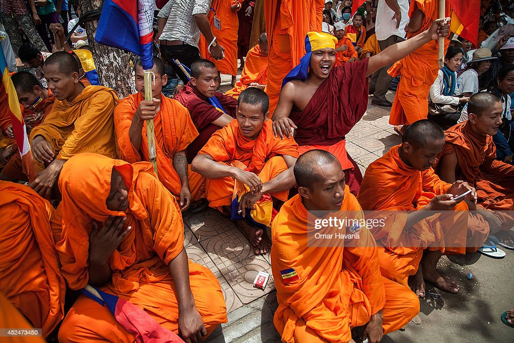 A group of Buddhist monks shout slogans while listening to speeches during a demonstration to deliver petitions to different embassies on July 21, 2014 in Phnom Penh, Cambodia. Thousands of protesters and monks march through the streets of Phnom Penh to deliver petitions to the French, British, American, Russian and Chinese embassies, before arriving at the Vietnamese Embassy. The protesters, organised by the Federation of Cambodian Intellectuals and Students (FCIS) and leaders of the Khmer Krom community, are demanding an apology from Vietnamese Embassy First Counsellor Tran Van Thong, who recently said that the former Kampuchea Krom provinces were held by Vietnam before their occupation by France. Ahead of the protest, Phnom Penh municipal authorities banned the protest, threatening the protesters who defied the ban could be jailed for up to 15 years.