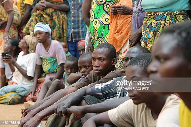 A group of Burundian refugees waits for a soap and blanket distribution at Gashora on Bugesera in April 10 2015 Since few weeks Burundian are fleeing...