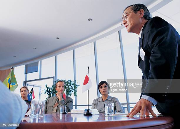 Group of Business Executives Having a Meeting Around a Conference Table