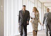 Group of business executives walking through corridor