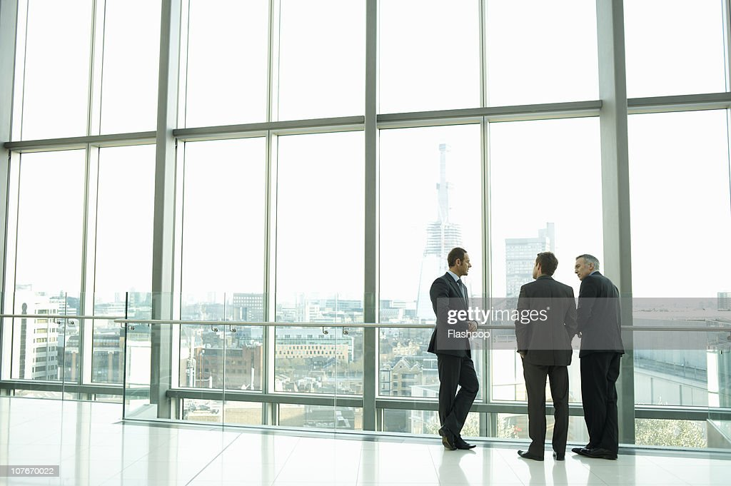 Group of business men having informal meeting : Stock Photo