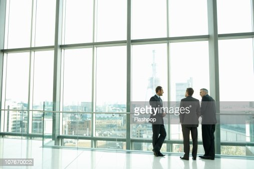 Group of business men having informal meeting : Stock Photo