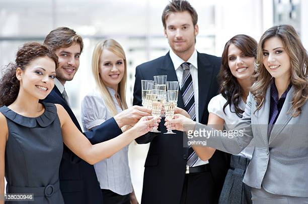 A group of business partners sharing a toast
