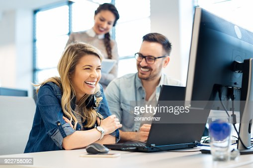 Group of business people and software developers working as a team in office : Stock Photo
