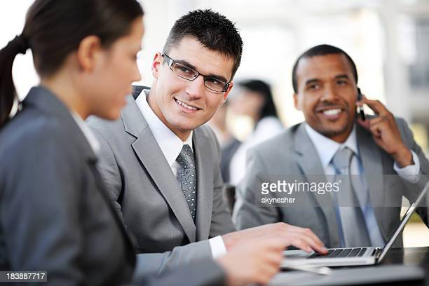 Group of business people at meeting.