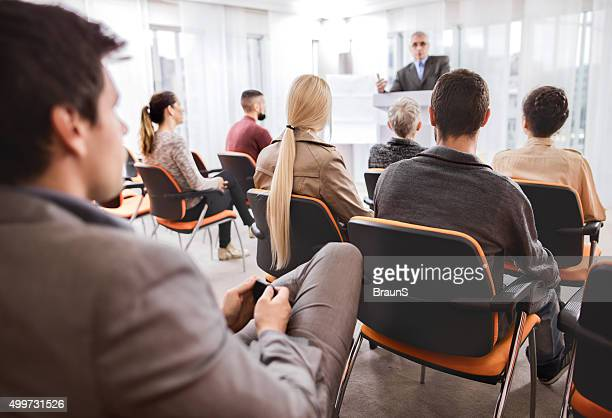 Group of business people attending an education event.