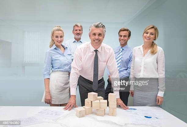 Group of business people building a project