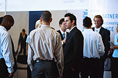 Group of business people discussing at exhibition