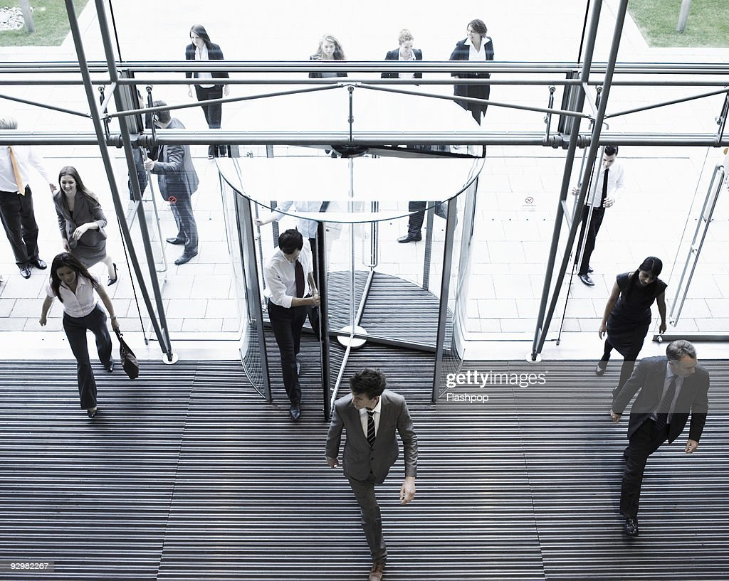 Group of business people entering a building