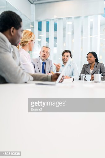 Group of business people having a meeting in the office.