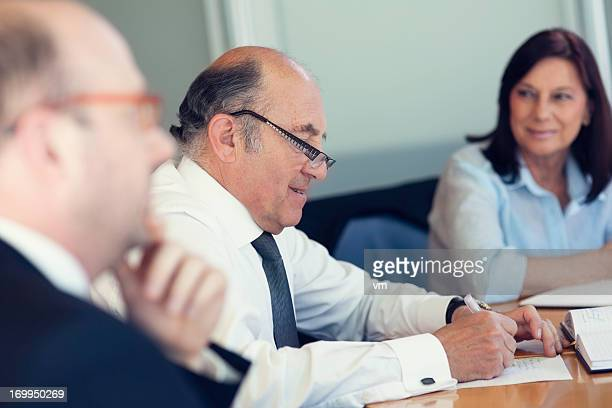 Group of Business People Having Board Meeting