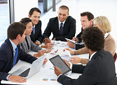 Group Of Business People Having Meeting In Office Round Table