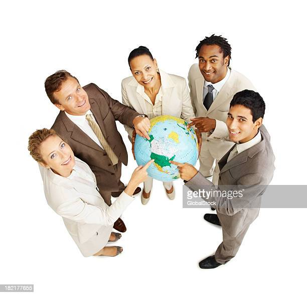 Group of business people holding globe