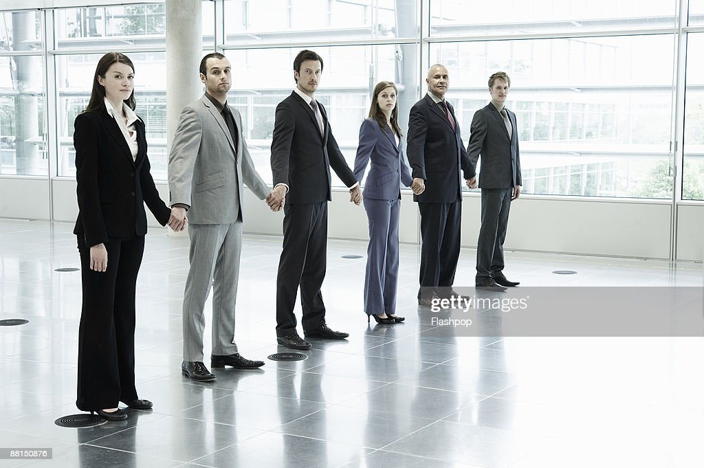 Technology Management Image: Group Of Business People Holding Hands Stock Photo