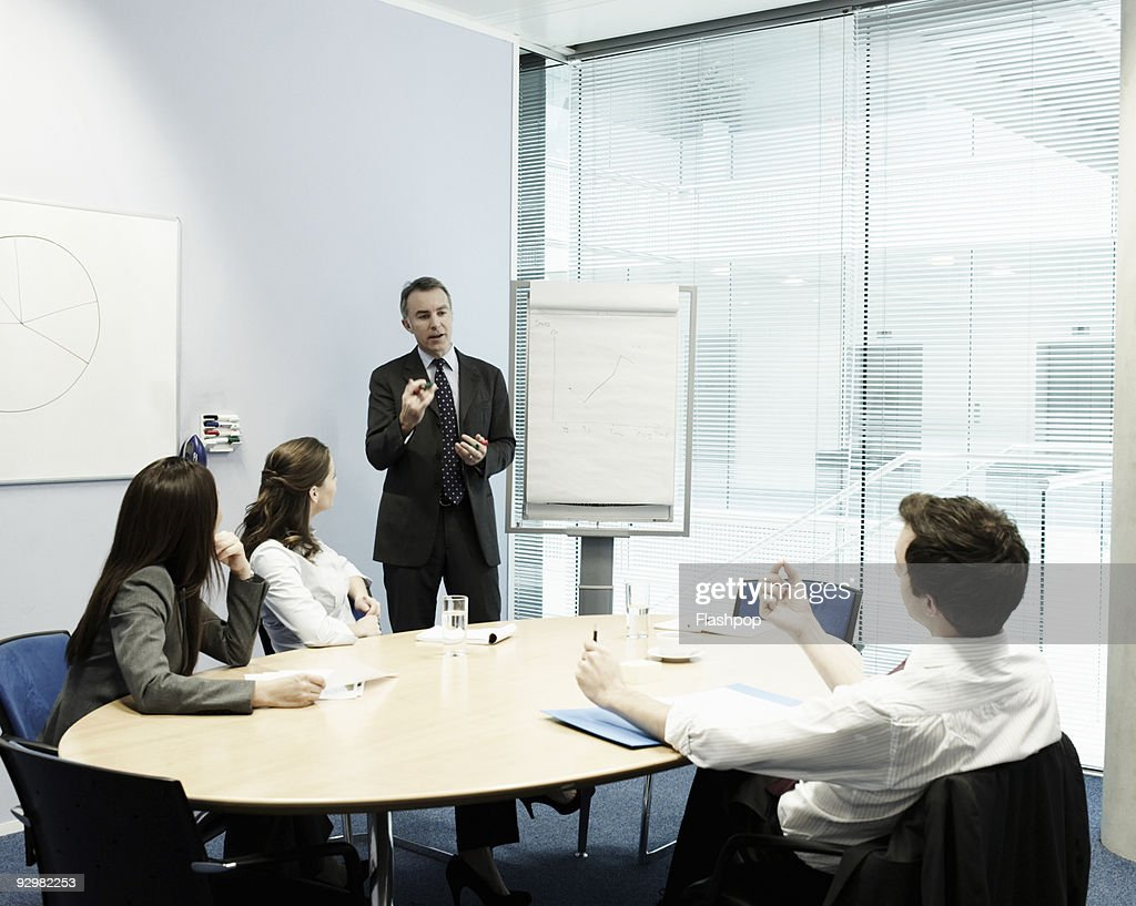 Group of business people in a meeting : Stock Photo