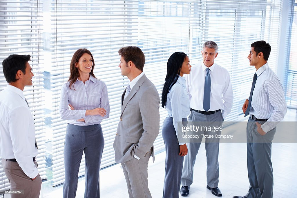 Group of business people in an office lobby : Stock Photo