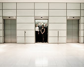 Group of business people inside an office lift