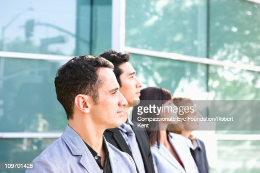 Group of business people looking into the distance : Stock Photo