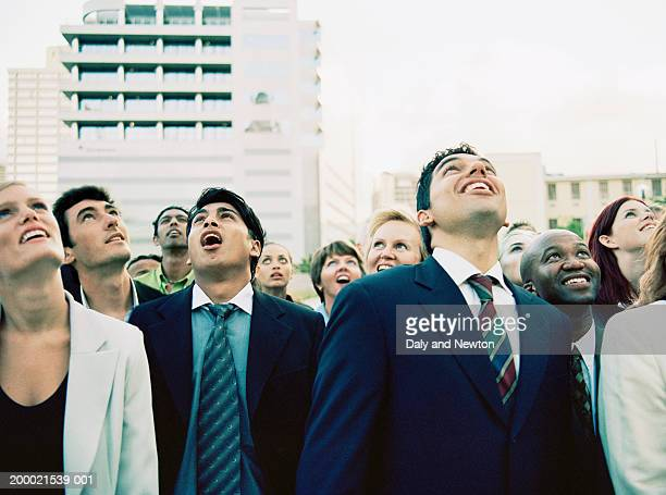 Group of business people looking up, mouths open